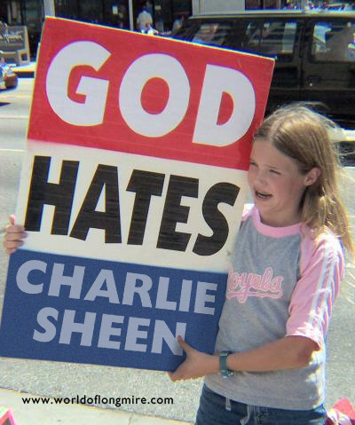"Misguided child holding ""God Hates Charlie Sheen"" placard."